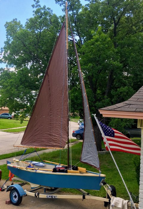 FAMILY TIME at home on trailer with sails full and US flag in front driveway.