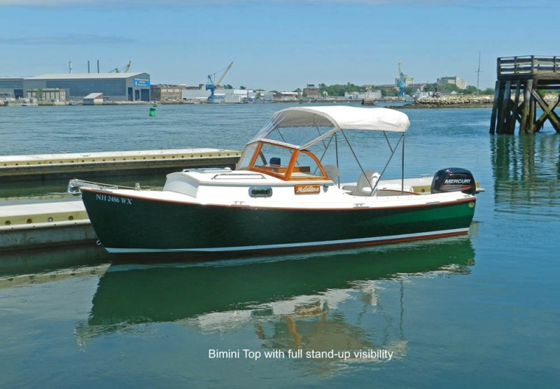 ADELINE docked in Portsmouth, NH - Bimini top with full stand-up visibility.