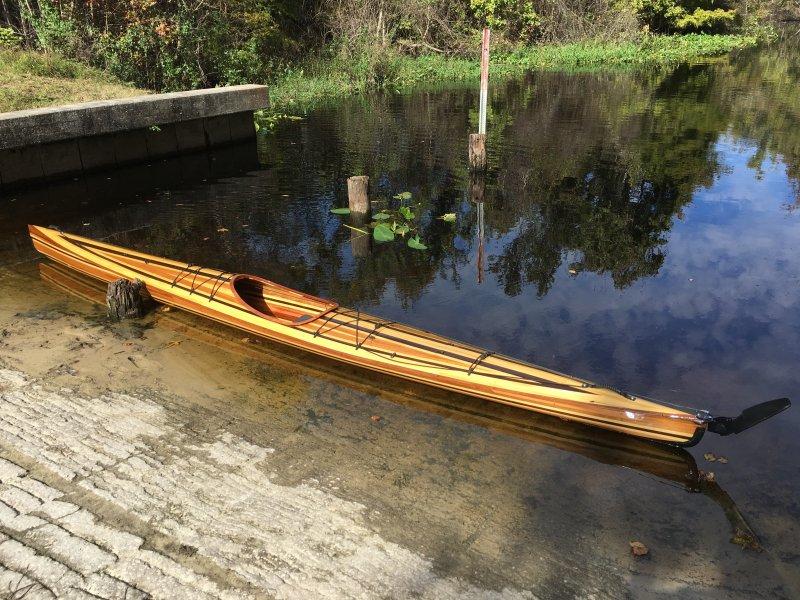 Strip-built Wahoo Fast Sea Kayak on the shore.