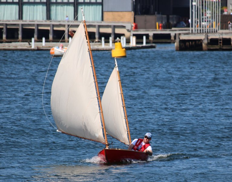Photo of strip built sailing canoe