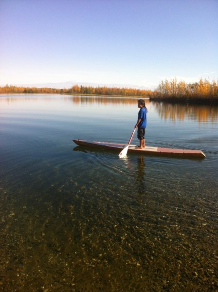 Stanley Madsen testing the shallows on his new paddleboard.