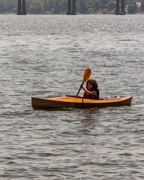 FLORA B., a Chesapeake Light Craft Wood Duckling kayak.