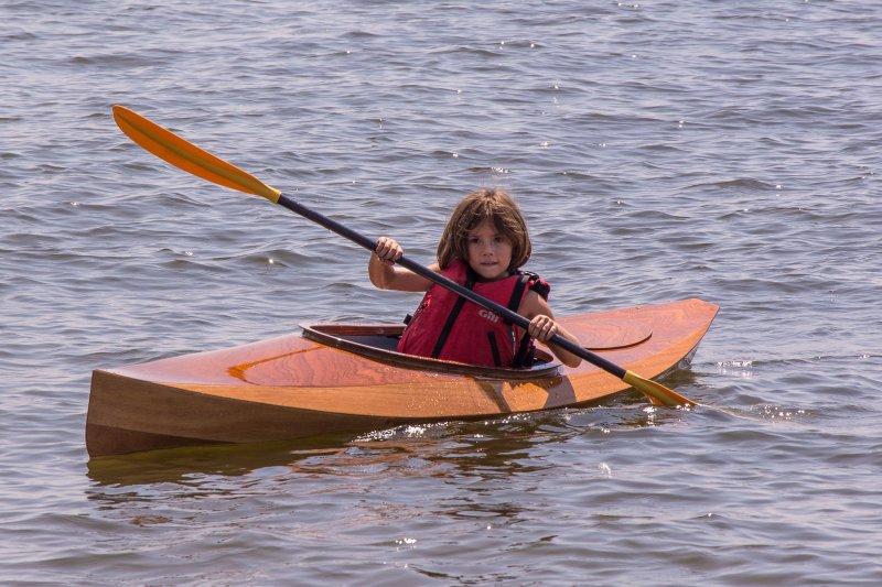 FLORA B., a Chesapeake Light Craft Wood Duckling kayak.