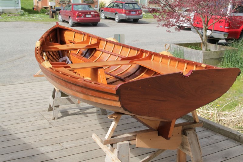 Bright finished inside and out, the Sid skiff sits awaiting launch.