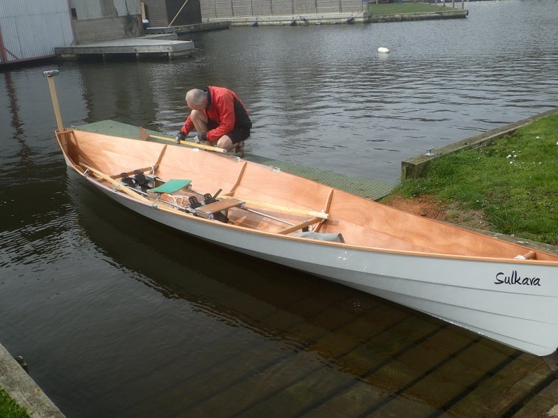 Sulkava two person sliding seat row boat that converts to a single.