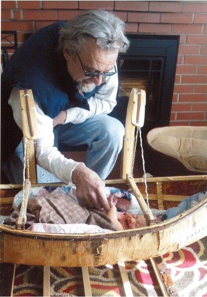 Grandpa checks on the newborn