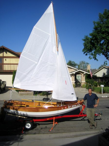 Passagemaker dinghy with sail.