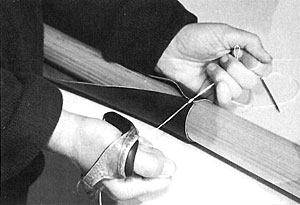 Begin sewing on the end closest to the oar grip.