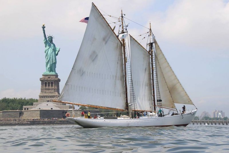 Arctic schooner BOWDOIN and Lady Liberty. Photo courtesy ACB Facebook.