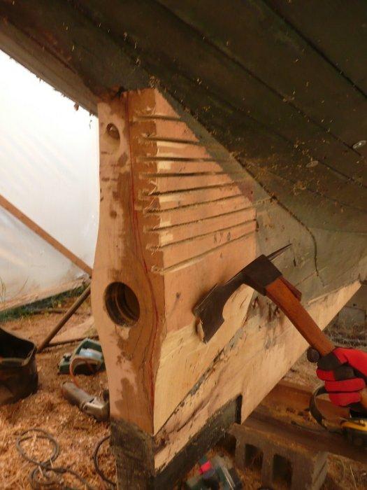 Josh Hermann, master shipwright, shaped the new black locust sternpost.