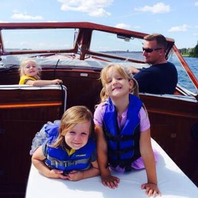 Family on a cruise down Snows Channel, Les Cheneaux Islands, MI