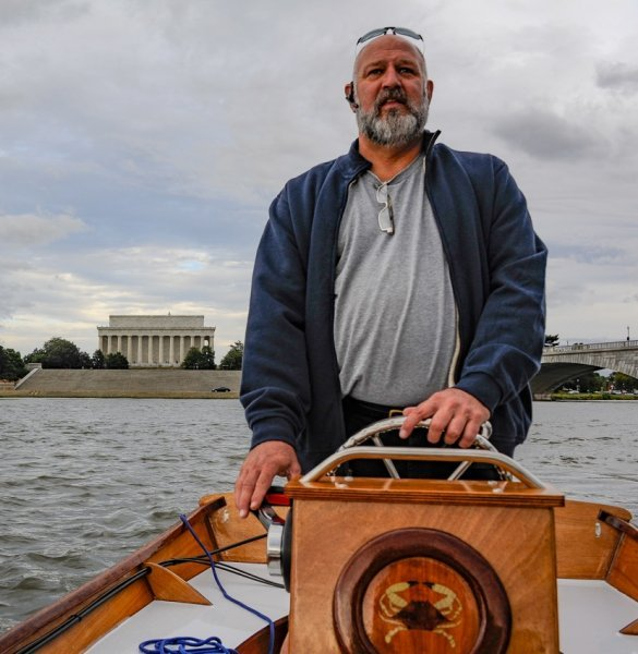 At the helm.