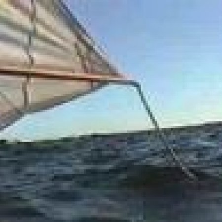 Canoe Sailing, Ocean, rough water, wave splashed rocks