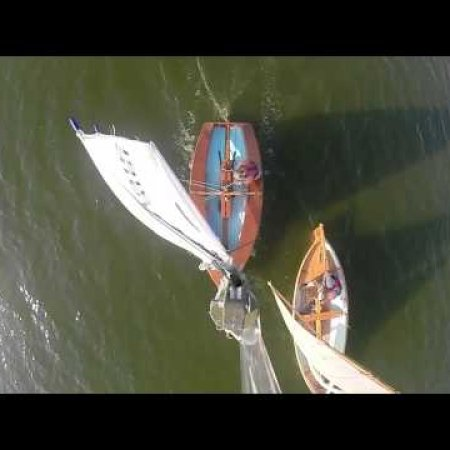 Wooden dinghy sailing - National Solo and Whillie boat
