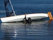 Viola 14 Sailing Canoe righting from capsize by Viola Spek the boat's namesake.