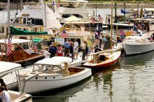 Custom-built boats docked for visitors to board at the Maine Boats, Homes & Harbors Show.