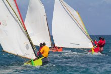 Grenada's traditional wooden, bamboo rigged workboats race in an annual Sailing Festival regatta.