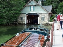 Visit 6 boathouses on Lake Winnipesaukee via vintage boat, vintage car, or  your own car