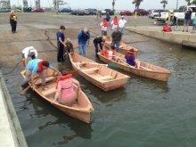 Family Boatbuilding at the Port Aransas plyWooden Boat Festival.