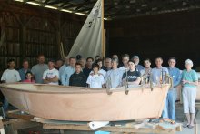 Family boat builders. Photo courtesy https://seagrant.unh.edu/family-boat-building.