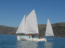 Peter Croft built his Pathfinder with the optional cabin, here he is on New Zealands Akaroa harbour