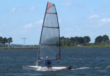 Viola 14 Sailing canoe planing freely, bow lifting without crew input